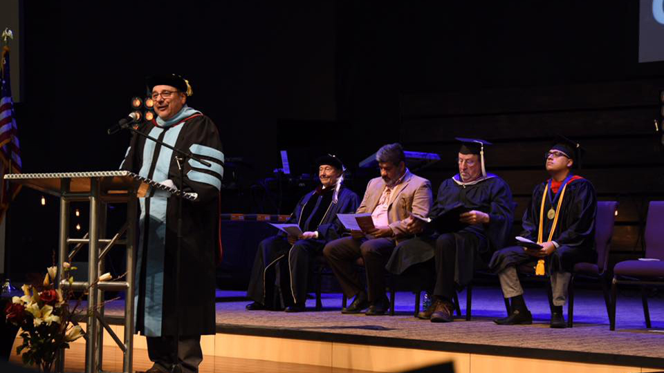 Dr. Saggio speaks during AIC's commencement ceremony