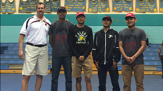 Coach Tom Kuyper (far left) stands with the four Alchesay High Seniors who signed